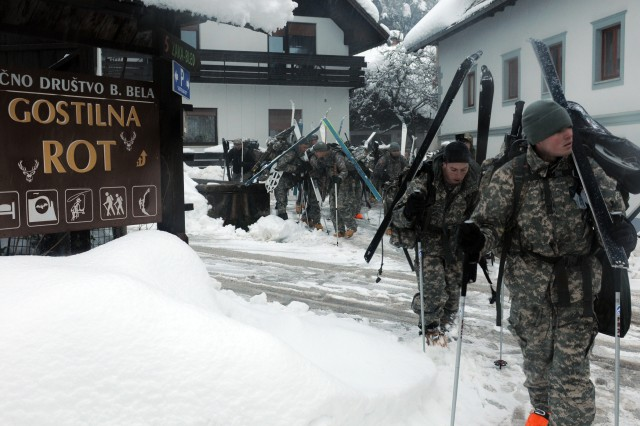 BOHINJSKA BELA, Slovenia -- Soldiers with U.S. Army Europe's 172nd Infantry Brigade set off on a long march back to their barracks during training at the Slovenian Armed Forces Mountain Training Center here, Dec. 2. Soldiers from the 172nd are participating in a weeklong mountain warfare training program at the school. For more photos of the training and other USAREUR images, visit www.flickr.com/photos/usarmyeurope_images. (Photo by Sgt. Joel Salgado)
