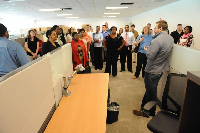 Aaron Vandiver (right), CECOM Contracting Center Information Technology Operations & Policy Division, discusses information technology issues with fellow contracting center employees.   CECOM Contracting Center personnel began moving into their new facilities on Aberdeen Proving Ground, Md., in October.