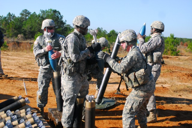 A team of students with the Indirect Fire Infantryman Advanced Leader Course hustle to shoot off suppressive fire during a live-fire exercise Wednesday. The live-fire was the culminating event of the six-week course and earned the students their certification.