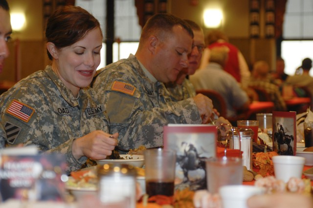 FORT HOOD, Texas - Sgt. Heather Goad, the electronic warfare non-commissioned officer in charge for 3rd Bde. Combat Team, 1st Cavalry Division, enjoys Thanksgiving dinner at the Operation Iraqi Freedom Memorial Dining Facility on Fort Hood, Nov. 25.
