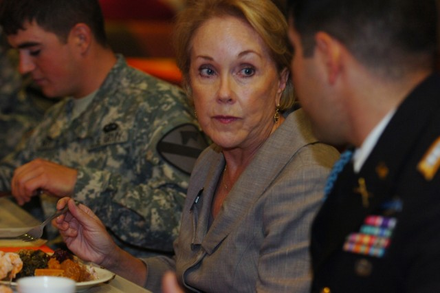 FORT HOOD, Texas - Dianne White Delisi, Civilian Aide to the Secretary of the Army for Fort Hood, eats her Thanksgiving meal with Soldiers at the Operation Iraqi Freedom Dining Facility Nov. 25.