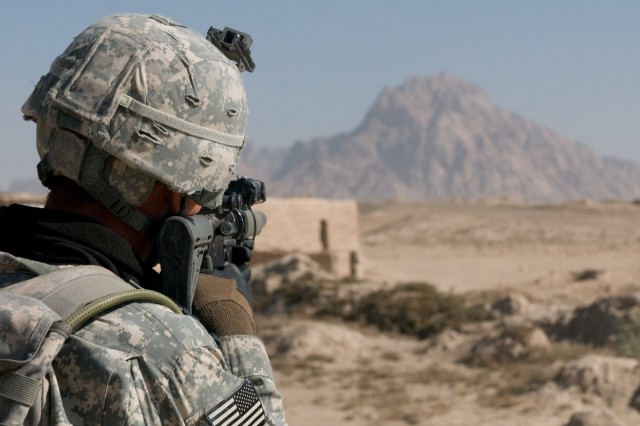 101124-A-5634G-003: Staff Sgt. Christopher M. Picache, 2nd squad leader for 3rd platoon, Company H (Hawk Company), 3rd battalion, 2nd Striker Cavalry Regiment , scans for threats through the scope on his M4 rifle during a patrol Nov. 24, in Maiwand District, Afghanistan. The purpose of the patrol was to make contact with a village key leader and a potential informant. (U.S. Army photo by Spc. Edward A. Garibay, 16th Mobile Public Affairs Detachment)