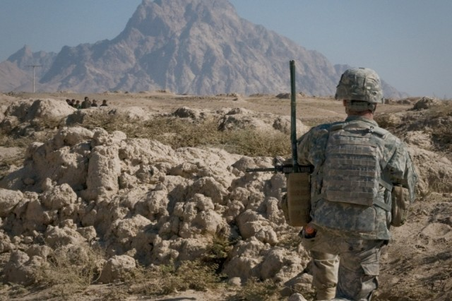101124-A-5634G-004: A Soldier from Company H (Hawk Company), 3rd battalion, 2nd Striker Cavalry Regiment, provides security during a patrol Nov. 24, in Maiwand District, Afghanistan. Security is maintained at all times during patrols. (U.S. Army photo by Spc. Edward A. Garibay, 16th Mobile Public Affairs Detachment)