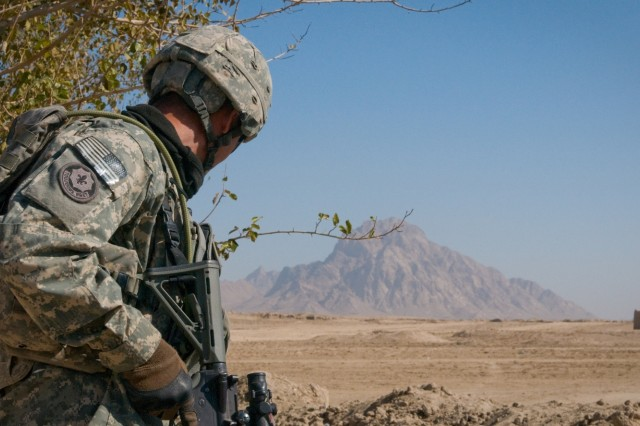 101124-A-5634G-006: Staff Sgt. Christopher M. Picache, 2nd squad leader for 3rd Platoon, Company H (Hawk Company), 3rd battalion, 2nd Striker Cavalry Regiment, scans an open area for threats before preparing to cross during a patrol Nov. 24, in Maiwand District, Afghanistan. Open areas are potentially dangerous areas for Soldiers because there is no place to find protection from enemy attacks. (U.S. Army photo by Spc. Edward A. Garibay, 16th Mobile Public Affairs Detachment)
