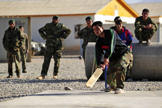 Afghan National Army soldiers play cricket on their newly constructed concrete cricket pitch Nov. 28. Captain Pat Trainor, Force Support 3 garrison engineer and civilian staff with Gulf Leighton provided the materials and labor to install the new pitch. (Australian Defence Force photo by Leading Seaman Paul Berry, 1st Joint Public Affairs Unit)