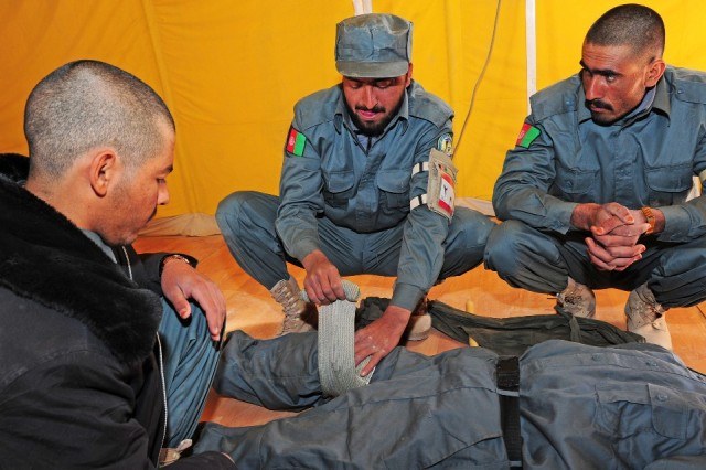 Afghan National Police recruits practice applying an emergency trauma bandage during first aid training at the Afghan National Training Center Nov. 30. (U.S. Army photo by Spc. Jennifer Spradlin, 16th Mobile Public Affairs Detachment)