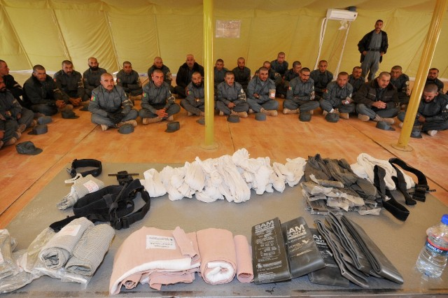 Afghan National Police recruits await their first aid training at the Afghan National Training Center Nov. 30. The training focuses on developing the skills to stop bleeding from severe wounds associated with improvised explosive devices or small arms fire. (Australian Defence photo by Cpl. Chris Dickson, 1st Joint Public Affairs Unit)