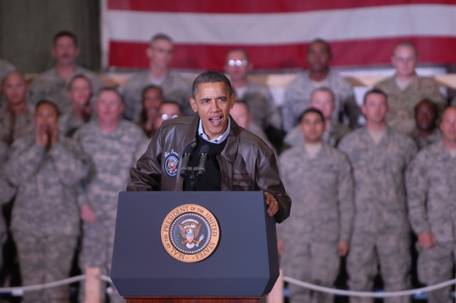 U.S. President Barack Obama addresses troops at Bagram Airfield during a surprise visit to Afghanistan, Dec. 3, 2010. He said the bravery, resolve, expertise and commitment of American servicemembers proves that AmericaAca,!a,,cs best days lie ahead.