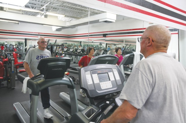 The President's Challenge defines activity as any movement that uses large muscle groups as opposed to sitting or lying down. Here, Harvey McKenzie uses a treadmill at Barnes Field House to stay active.
