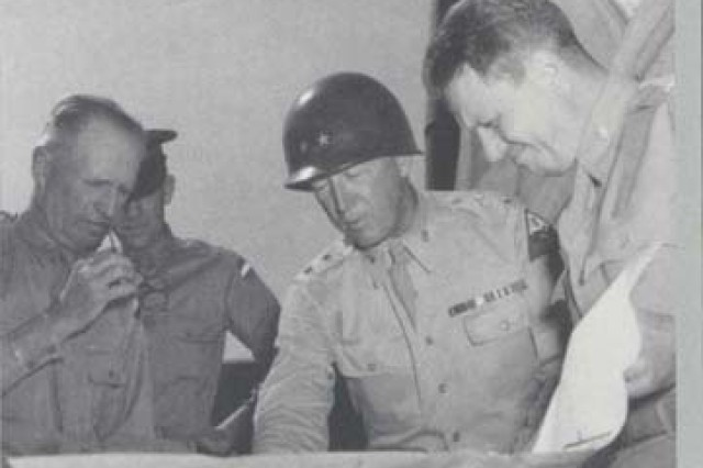 General Lesley J. McNair (left) and Maj. Gen. George S. Patton, Jr., study a map.   During World War II, McNair served as the chief trainer of the U.S. Army, first as Chief of Staff of General Headquarters (1940-1942) and then as Commanding General of the Army Ground Forces (1942–1944). McNair oversaw the development of a systematic training and testing program for the ninety divisions that the Army mobilized during the war. He was killed by a misdirected American bomb while     observing operations near St. Lô, France, on July 25, 1944.