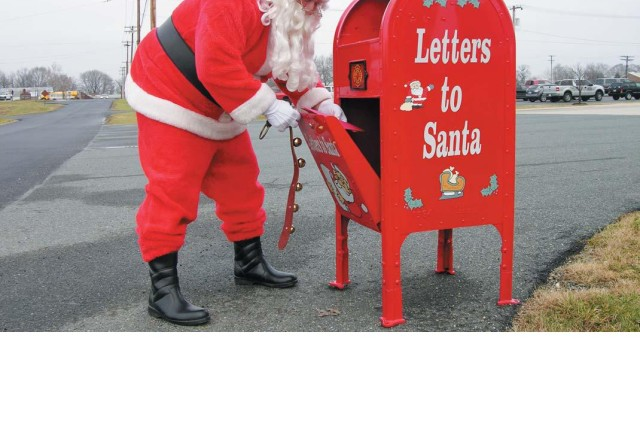 Old St. Nick checks the Letters to Santa mailbox for holiday wishes from Aberdeen Proving Ground children. The mailbox is located next to the Emergency Services building, 2200 Frankfort Street. Letters will be collected daily through Dec. 21, and each letter will be answered, according to APG fire inspector T.C. Glassman. For more information, call 410-306-0600.