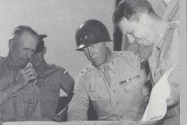 Maj. Gen. George S. Patton Jr. (center) studies a map during World War II with General Lesley J. McNair (left), chief of staff of General Headquarters and later commanding general of U.S. Army Ground Forces.
