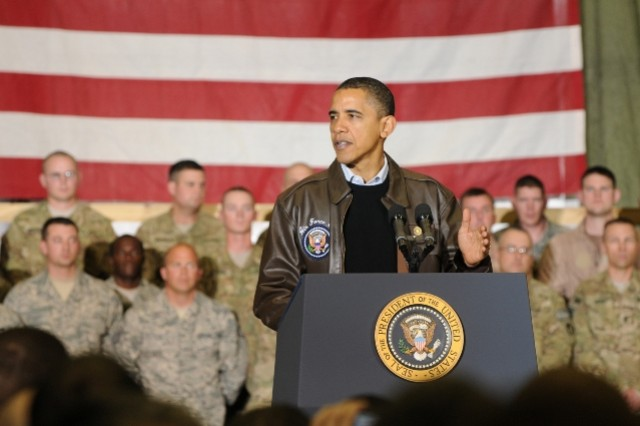Barack Obama thanks a crowd of servicemembers and civilians during a surprise visit to Bagram Airfield Dec. 3.