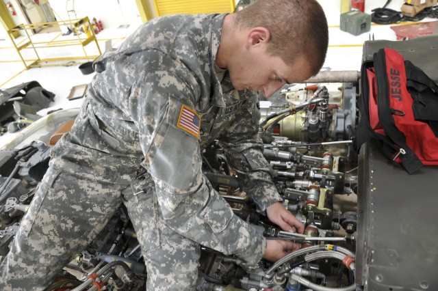Private First Class Mark Rios, a UH-60 Black Hawk repairer, C Company, 3rd Battalion, 25th General Support Aviation Battalion, 25th Combat Aviation Brigade, from Cocoa, Fla., resets the controls of a hydraulic system of a UH-60 Black Hawk helicopter at Wheeler Army Airfield, Nov. 15.(Photo by Sgt. Karl Williams  25th Combat Aviation Brigade Public Affairs)