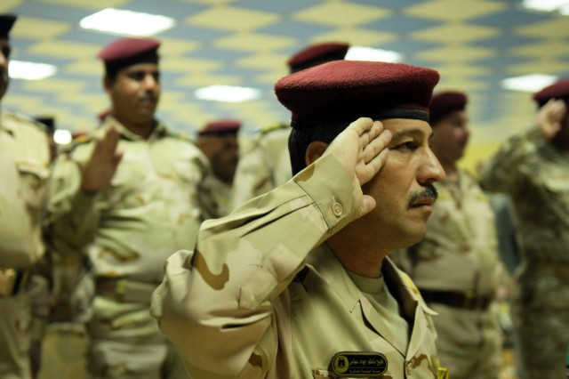 101206-A-8580M-944.jpg - BAGHDAD - Army Col. Falaeh Ndem Jawad, commander of the Iraqi Army Engineer School, salutes during a ceremony unveiling the School's newly-constructed graduation hall at Camp Taji Dec. 6.