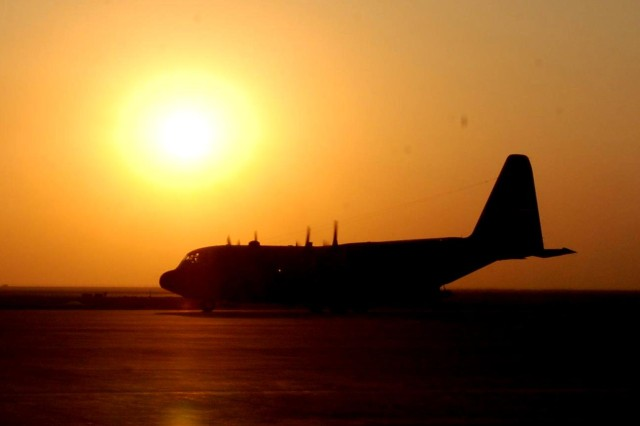 A United States Air Force C-130 Hercules taxis down the runway at Basra International Airport. The C-130 was carrying the torch party of the 36th Infantry Division, which is relieving the 1st Infantry Division as the United States Division-South headquarters.