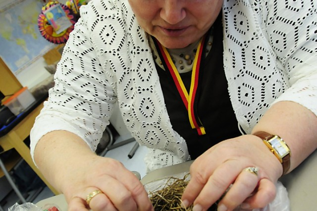 Elfriede Kean showcases a real bird's nest she brought in to show her class.