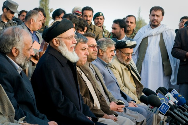 101206-A-5634G-002: Professor Burhanudin Rabini (second from left), Afghan High Peace Council chairman, fields questions along with southern Afghan provincial governors during a press conference Dec. 6, in Kandahar City, Afghanistan.  The High Peace Council is an organization set up by Afghan President Hamid Karzai to promote peace talks with the Taliban. (U.S. Army photo by Spc. Edward A. Garibay, 16th Mobile Public Affairs Detachment)