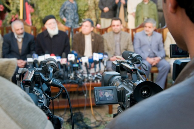 101206-A-5634G-003: Members of the High Peace Council and southern Afghan provincial governors answer questions during a press conference Dec. 6, in Kandahar City, Afghanistan.  The purpose of the press conference was to let the people of Afghanistan know about the efforts of the High Peace Council, an organization set up by Afghan President Hamid Karzai to promote peace talks with the Taliban. (U.S. Army photo by Spc. Edward A. Garibay, 16th Mobile Public Affairs Detachment)