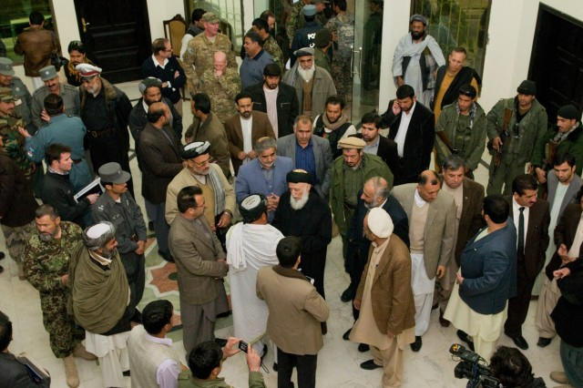 101206-A-5634G-004: Afghan provincial governors and members of the High Peace Council, an organization set up to promote peace talks with the Taliban, socialize Dec. 6, in Kandahar City, Afghanistan before a conference to discuss Taliban reintegration. (U.S. Army photo by Spc. Edward A. Garibay, 16th Mobile Public Affairs Detachment)