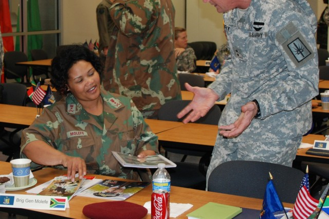 Maj. Gen. Patrick Murphy, the adjutant general of New York, speaks with South African Brig. Gen. Susan Molefe, the director of Defence Reserves, during a break in a joint South African/New York National Guard Conference held at New York National Guard Headquarters in Latham, N.Y., Dec. 4.