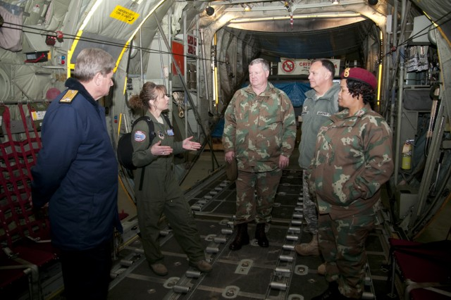 New York Air National Guard Master Sgt. Kerri Booth, a loadmaster with the 109th Airlift Wing, explains duties onboard her unit's LC-130 Hercules aircraft to members of a South African National Defence Force Reserves delegation Dec.5. Pictured are (from left)  South African Rear Adm. Earnst Penzhorn, director of Naval Reserves; Booth; South African Maj. Gen. Roy Andersen, chief of Defence Force Reserves; Brig. Gen. Isaac Osborne, deputy commander of U.S. Army Africa; and South African Brig. Gen. Susan Molefe, director of Defence Reserves.