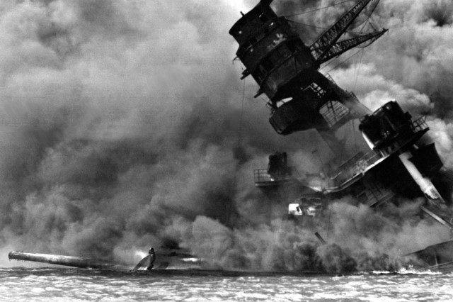The USS ARIZONA burning after the Japanese attack on Pearl Harbor Dec. 7, 1941.