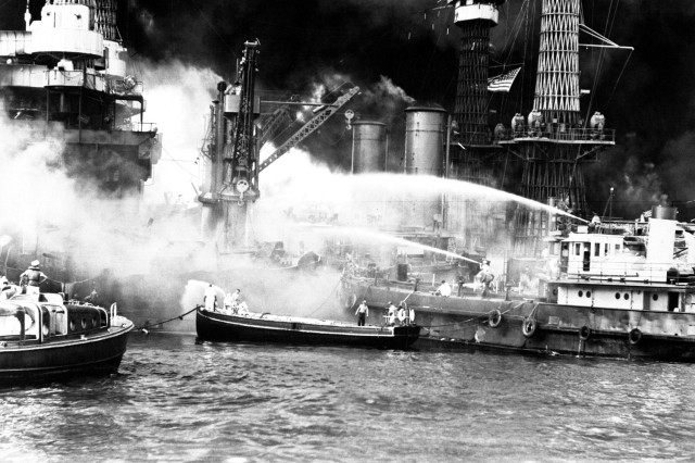 Pearl Harbor, taken by surprise, during the Japanese aerial attack. USS WEST VIRGINIA aflame Dec. 7, 1941.