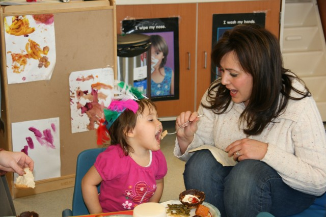 FORT CARSON, Colo. -- Andrea Adams feeds her daughter, Alaina, during the Thanksgiving lunch at the Southeast Child Development Center Nov. 18.