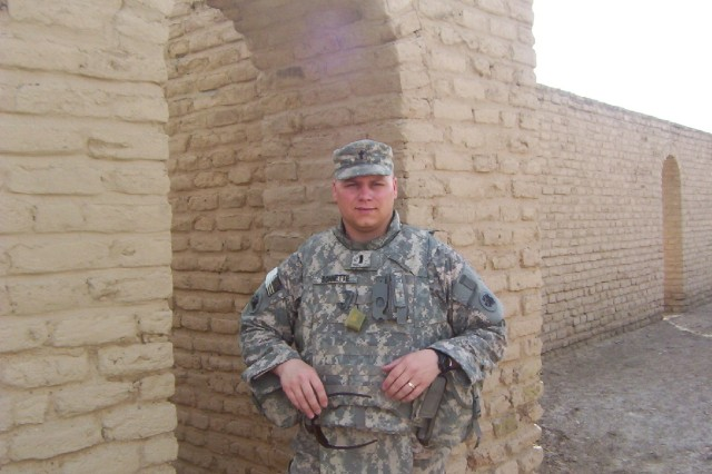 U.S. Army 1st Lt. Matthew Bonnette, chaplain with the 110th Combat Sustainment Support Battalion, 224th Sustainment Brigade, 103rd Sustainment Command (Expeditionary), and a Blakely, Ga., native, stands in front of Abraham's home, April 29, near Contingency Operating Base Adder, Iraq. The building was partially restored under Saddam Hussein in anticipation of a visit from Pope John Paul II.