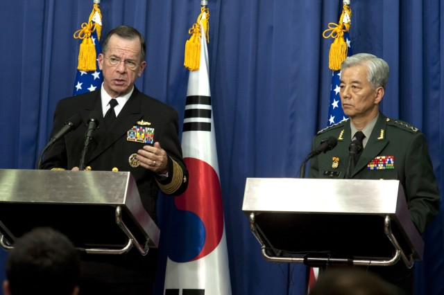 U.S. Navy Adm. Mike Mullen, chairman of the Joint Chiefs of Staff, and Gen. Han Min-koo, chairman of the South Korean Joint Chiefs of Staff, address the media during a joint press conference in Seoul, South Korea, on Dec. 8, 2010.
