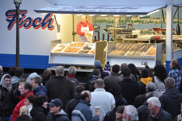 Vendors shout about their wares early Sunday morning at the Hamburg Fish Market.