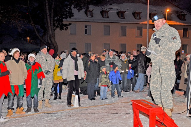 Col. Jeffrey Dill, U.S. Army Garrison Wiesbaden commander, talks about the meaning of the holidays and welcomes returning 1st Armored Division Soldiers home from duty in Iraq during the tree lighting ceremony.