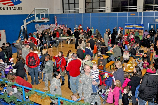 Families mingle, enjoy games and refreshments at the U.S. Army Garrison Wiesbaden tree lighting event.