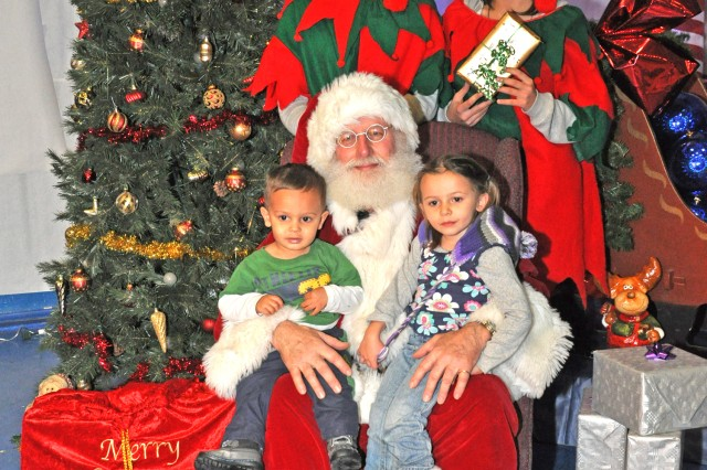 Youths pose for a photo with Santa at the U.S. Army Garrison Wiesbaden tree lighting event.