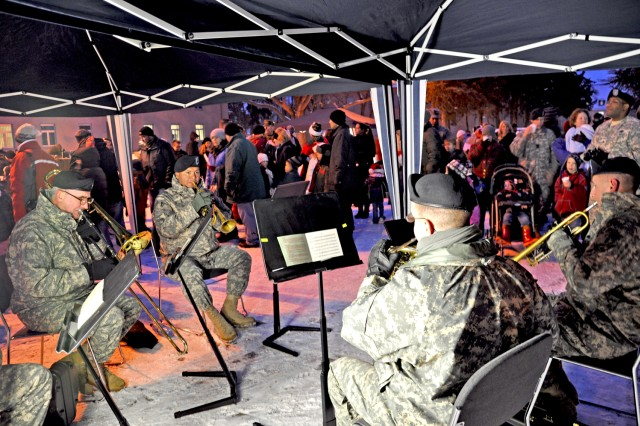 Members of the U.S. Army Europe Band perform holiday carols during the U.S. Army Garrison Wiesbaden Christmas tree lighting event Dec. 3.