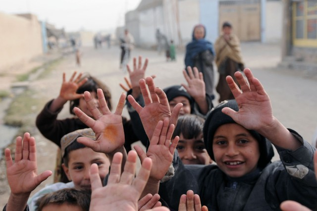 KANDAHAR CITY, Afghanistan-- Children in Popal colony in Kandahar City, Afghanistan, waved to Soldiers as they pulled security through the town Dec. 5.  (Photo by Staff Sgt. LaSonya Morales, 16 Mobile Public Affairs Detachment)