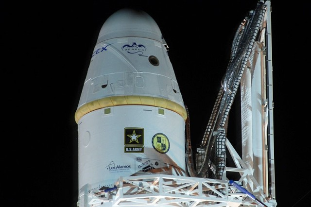 The U.S. Army logo is prominently positioned on the SpaceX Falcon 9 rocket the night before launch. The first Army-built satellite in more than 50 years, SMDC-ONE nanosatellite, is onboard the second stage directly behind the Army logo.