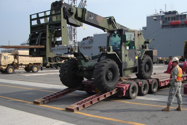 A 25th Transportation Battalion Soldier directs the download of an All-terrain Lifter, Army System forklift during operations Dec. 7 at the Port of Gwangyang, South Korea. The ATLAS, from Army Field Support Battalion - Northeast Asia, was added to prepositioned materiel aboard the USNS Watson.