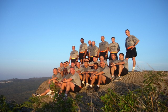 """HONOLULU--U.S. Army Pacific Headquarters staff took a break during Dec. 7's """"Chief of Staff"""" run. The group hiked up Koko Head crater on the eastern side  of Oahu. The staff took a moment to remember hose service members and American's who lost their lives during the Dec. 7, 1941 attack on Pearl Harbor. The dash up to the top of the dormant volcano, 1200 feet, challenged the group."""