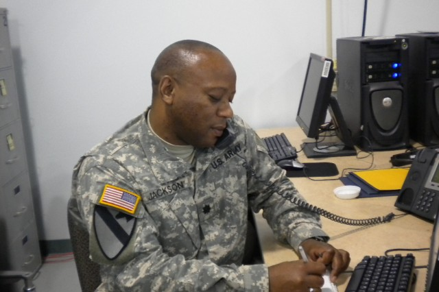 Lt. Col. (P) Tonie D. Jackson works at his station during an exercise at Joint Base Lewis-McChord. He was recently recognized as a candidate for a prestigious Secretary of the Army award, BCTP professionals travel world-wide in support of the unit's training mission.