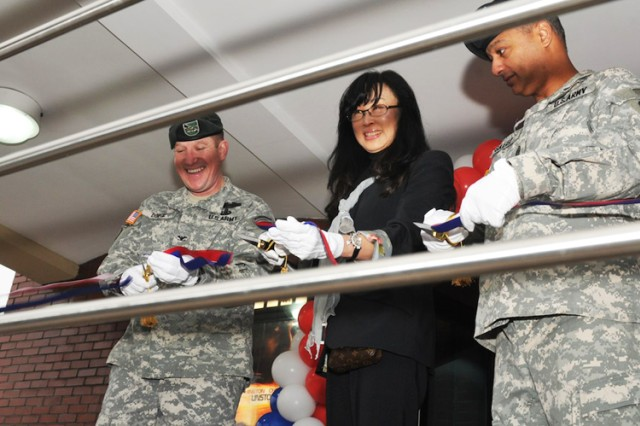 Col. Hank Dodge (left), U.S. Army Garrison Red Cloud commander, Gloria Cho, AAFES Area I manager, and Command Sgt. Maj. Nidal Saaed, USAG Red Cloud command sergeant major, cut the ribbon during the grand reopening at the Red Cloud Theater Dec. 1.