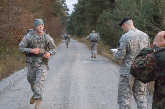Spc. Terry Gasser from the 529th Military Police Company, 95th MP Battalion, checks in at the halfway point of the 12-kilometer ruck march, an event of the German Armed Forces Efficiency Badge Nov. 24 in Mannheim