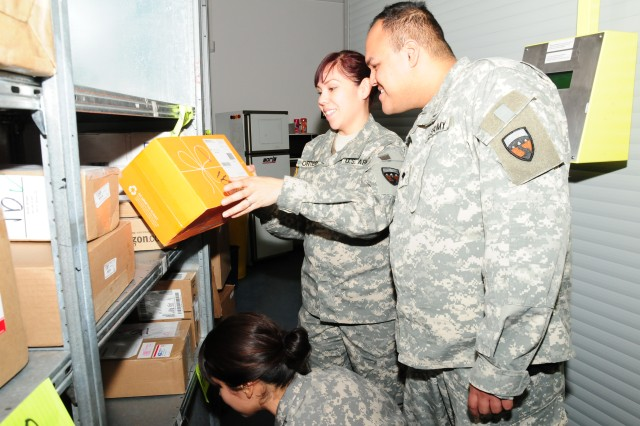 Army reservists Spc Mayra Ortega, Spc Eric Colio and Spc Veronica Rodriguez (below)  all from the 376th HR Company out of Los Angeles, help sort, stack and process holiday packages coming into the Community Mail Room 419 on Patton Barracks in Heidelberg Dec.7. Members of the unit are deployed to Germany to conduct annual training in postal operations.