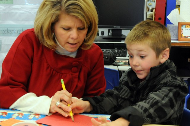 Sara Dawkins, Fort Rucker Primary School resource teacher, helps Matty Taylor make a card.