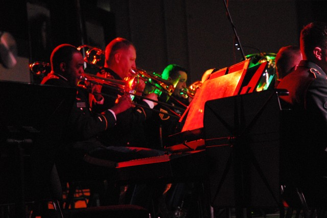 """From left, Staff Sgts. Lawrence Patterson and  Jamie Resset, trombonists with the 282nd Army band, belt out """"A Christmas Festival"""" during the band's annual holiday concert."""