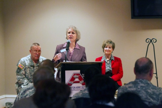 Sherri Sumners, president of the Calhoun County Chamber of Commerce, speaks at the Army Community Covenant Ceremony Nov. 30 at Anniston Army Depot.