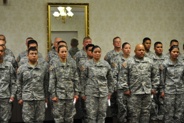 Twenty-one Soldiers became U.S. citizens during the first naturalization ceremony held at Fort Irwin, Calif. on Dec. 9, 2010.