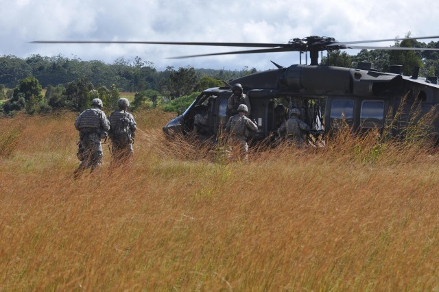 A UH-60 Black Hawk helicopter assigned to 2nd Assault Helicopter Battalion, 25th Aviation Regiment, 25th Combat Aviation Brigade, lands to pick up Soldiers from A Troop, 3rd Squadron, 4th Cavalry Regiment, 3rd Infantry Brigade Combat Team, 25th Infantry Division, after an air assault training exercise at East Range, near Wheeler Army Airfield, Nov. 30.   (Photo by Sgt. Karl Williams  25th Combat Aviation Brigade Public Affairs)