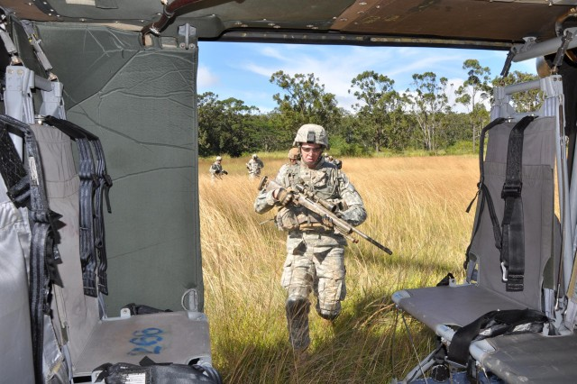 Soldiers from A Troop, 3rd Squadron, 4th Cavalry Regiment, 3rd Infantry Brigade Combat Team, 25th Infantry Division, quickly loads back onto a UH-60 Black Hawk assigned to 2nd Assault Helicopter Battalion, 25th Aviation Regiment, 25th Combat Aviation Brigade, after an air assault training exercise at East Range, near Wheeler Army Airfield, Nov. 30.  (Photo by Sgt. Karl Williams  25th Combat Aviation Brigade Public Affairs)